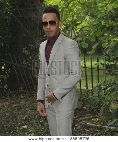 LONDON, UK, JUNE 15, 2015: Lewis Hamilton attends the Burberry Prorsum fashion show London Collections