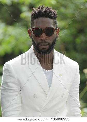 LONDON, UK, JUNE 15, 2015: Tinie Tempah attends the Burberry Prorsum fashion show picture taken from the street