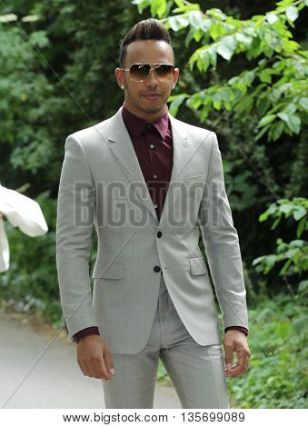 LONDON, UK, JUNE 15, 2015: Lewis Hamilton attends the Burberry Prorsum fashion show image taken form the street