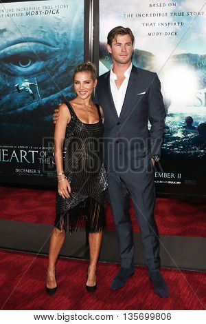 NEW YORK-DEC 7: Actor Chris Hemsworth (R) and Elsa Pataky attend the premiere of