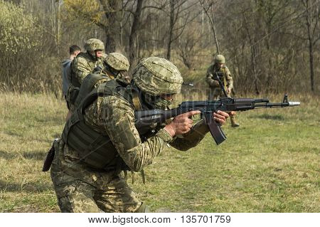 Military soldiers at tactical exercises with guns poster