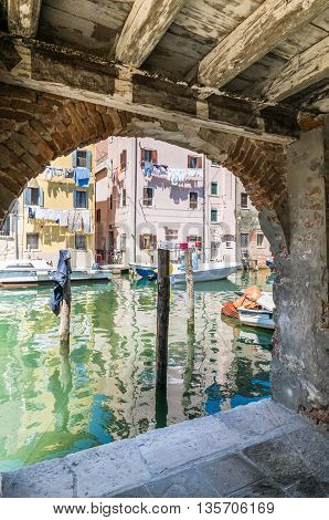 Chioggia glimpse from the arcades along the canals.