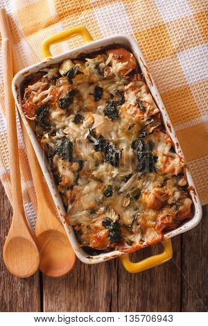 Strata Casserole With Spinach, Cheese And Bread Close Up. Vertical Top View