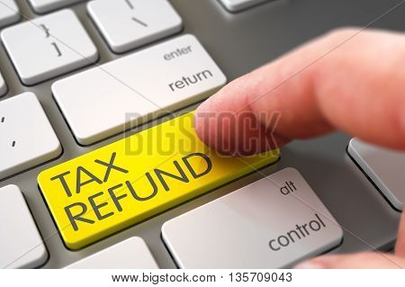 Hand using Laptop Keyboard with Tax Refund Yellow Button, Finger, Laptop. Tax Refund - Aluminum Keyboard Concept. Tax Refund Concept. 3D Illustration.