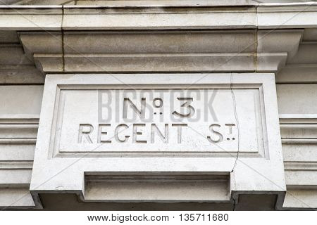 A sculptured sign for No. 3 Regent Street in central London.
