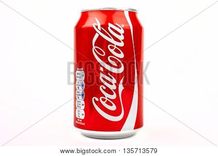 LONDON UK - MAY 6TH 2016: A can of Coca Cola drink isolated over a plain white background on 6th May 2016. The drink is produced and manufactured by The Coca-Cola Company.