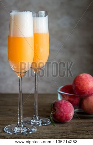 Two Bellini Cocktails With Fresh Peaches