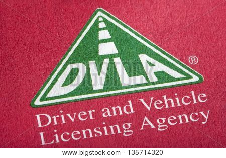 LONDON UK - APRIL 25TH 2016: The DVLA logo on an information booklet on 25th April 2016. DVLA stands for the Driver and Vehicle Licensing Agency and is responsible for maintaining a database of drivers and vehicles in the UK.