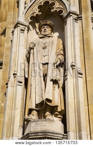 A statue of Sir Nicholas Bacon Lord Keeper of the Great Seal on the exterior of Corpus Chisti College in Cambridge UK.