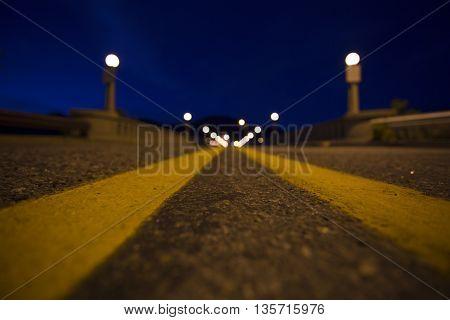The double yellow lines leading over the bridge to Washington's Lake Chelan.