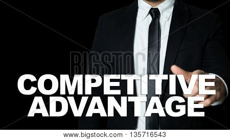 Business man pointing the text: Competitive Advantage