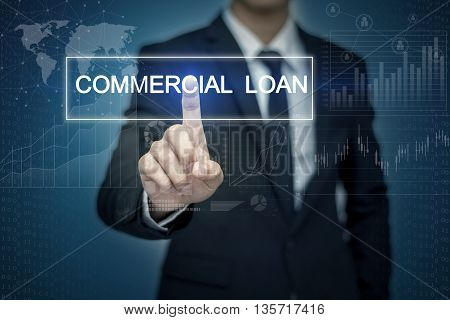 Businessman hand touching COMMERCIAL LOAN button on virtual screen