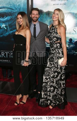 NEW YORK-DEC 7: (L-R) Renee Puente, Matthew Morrison and Marlett attend the New York premiere of