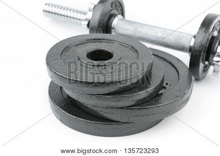 Black steel dumbbell on isolated white background