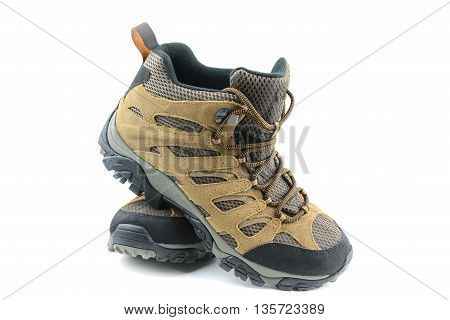 Brown hiking shoes classic design on isolated white background