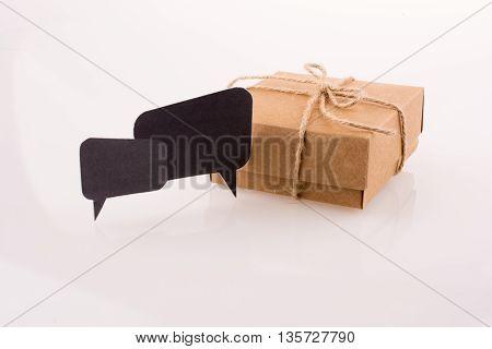 Dialogue boxes near a carton box on a white background