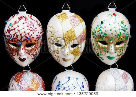 A row of traditional Venetian masks at the shop