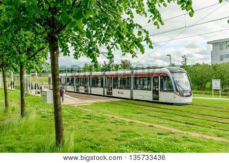 EDINBURGH SCOTLAND - JUNE 20 2016: A commuter tramcar service at Edinburgh Park to the west of the city.