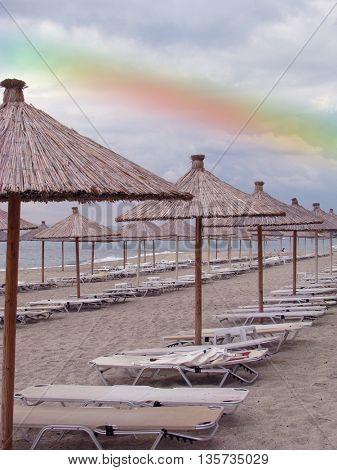 rainbow under empty beach