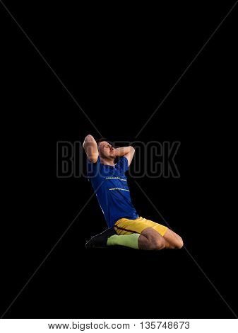 Frustrated soccer player in blue uniform isolated on football training isolated
