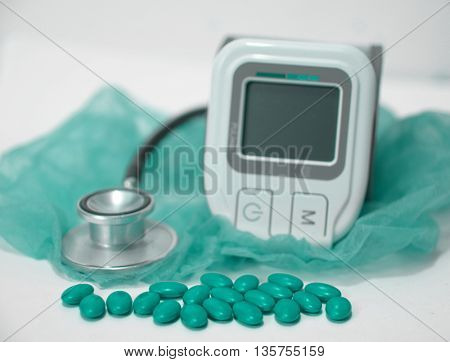stethoscope,device for measuring blood sugar level and pills
