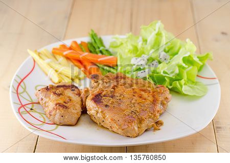 Grilled Steaks On Dish With Salad