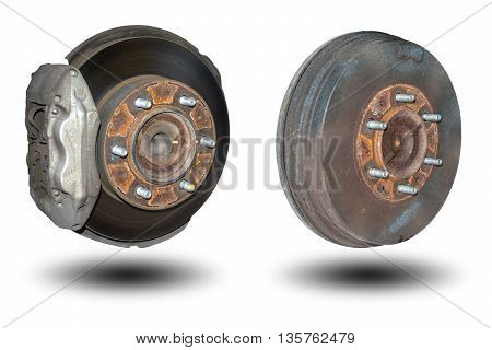 Old rusty disc brakes front wheel and back drum brakes of the car isolated on white background.