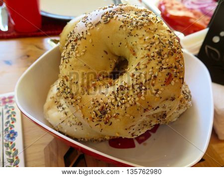 Bowl of everything bagels displayed on breakfast table