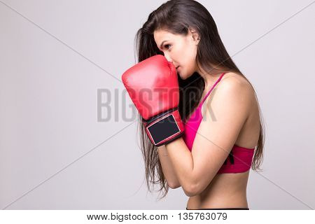 Latina young girl with boxing gloves