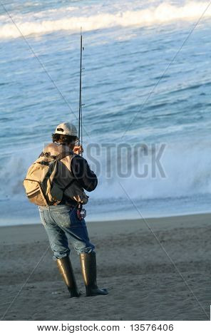 A photo of a man fishing from the beach