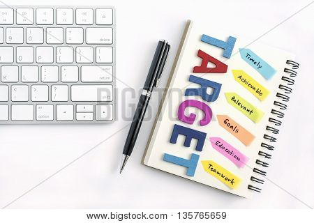 Alphabet letters words target with handwriting timely achievable relevant goals education teamwork on the notebook with pen and keyboard isolated on white background, business success concept