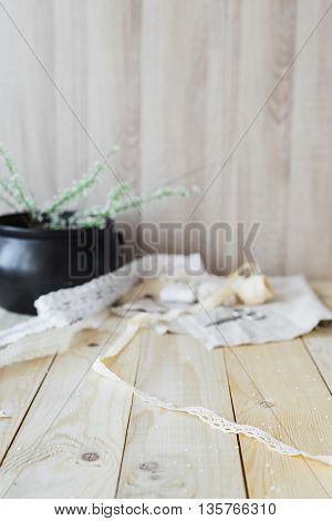 crafts concept lace ribbon and flowering branch on wooden table soft focus