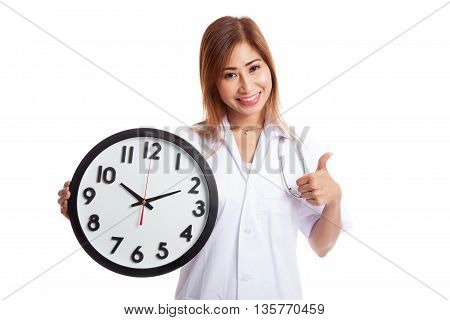Young Asian Female Doctor Thumbs Up With A Clock