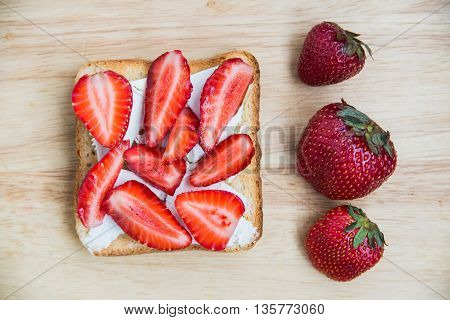 top view crispy toast with feta cheese and fresh strawberry harvest