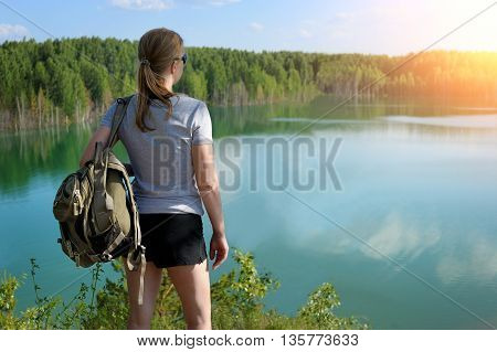 Hiker Staying On Top Near A Beautiful Lake.