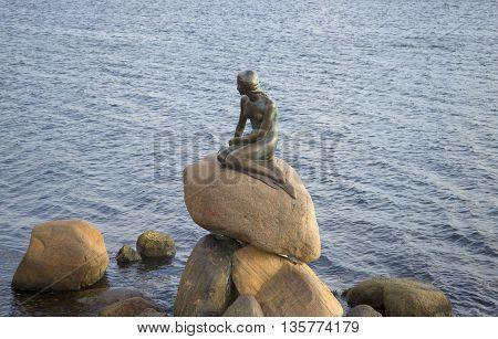 COPENHAGEN, DENMARK - NOVEMBER 03, 2014: The sculpture of the little Mermaid, autumn evening. The main landmark of the city Copenhagen, Denmark