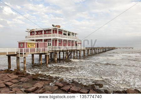 GALVESTON USA - APR 13: Fishing and leisure pier at the Gulf of Mexico coast in Galveston Island. April 13 2016 in Galveston Texas United States