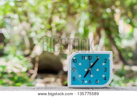 blue alarm clock on bokeh background,Close up blue alarm clock