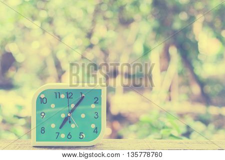 blue alarm clock on bokeh background,Close up blue alarm clock,vintage tone