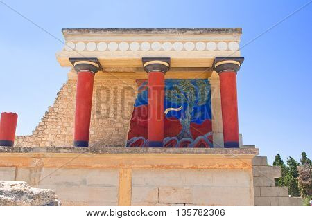 Knossos palace with charging bull fresco at the background on the Crete island Greece.