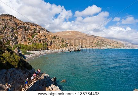 CRETEGREECE-JULY 23:Tourists go down to the Preveli Beach on July 232014 on Crete Greece. The beach of Preveli is situated 40 km south of the main town and is the most idyllic beach in Crete.