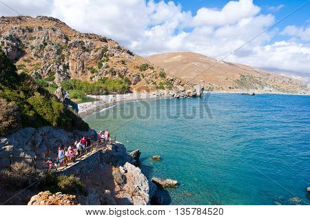 CRETEGREECE-JULY 23:Tourists come down on the Preveli Beach on July 232014 on Crete Greece. The beach of Preveli is situated 40 km south of the main town and is the most idyllic beach in Crete.