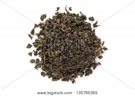 Organic Green Tea (Camellia sinensis) dried long leaves isolated on white background. Macro close up. Top view.