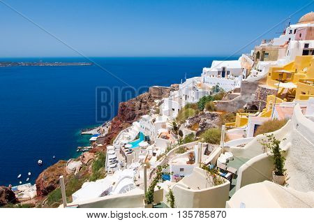 Colorful Oia town on the edge of the Santorini Caldera cliffs on the island of Thira (Santorini) Greece.