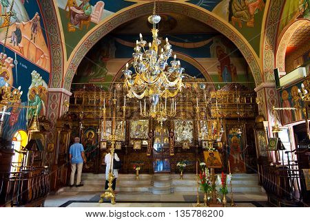 SANTORINIOIA-JULY 28: Interior of the Church of Agia Irini on July 282014 in Oia town on the Santorini island Greece. Oia is a small town on the islands of Thira (Santorini) and Therasia Greece.