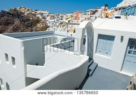 Typical caved house with patio in Fira town on the Santorini (Thira) island in Greece.