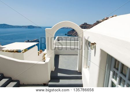 Etrance to the caved house with patio in Fira town on the Santorini (Thira) island in Greece.