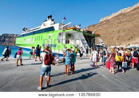 SANTORINI-JULY 28: Tourists board on the ferry on July 28 2014 on the port of Thira. Santorini Greece.