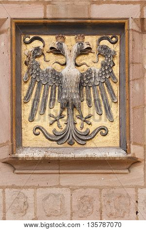 NURNBERG /GERMANY - JULY 17th 2014: closeup photo of double headed crowned vulture imperial sign embedded in building wall