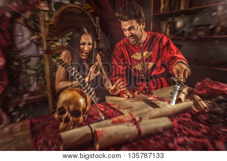 Medieval inquisitor is tempting witch to sign the confession.
